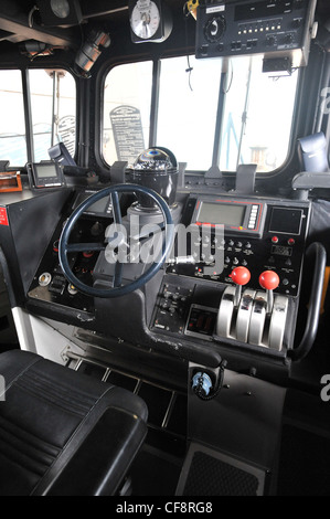 RNLI lifeboat wheelhouse helm - Stock Photo