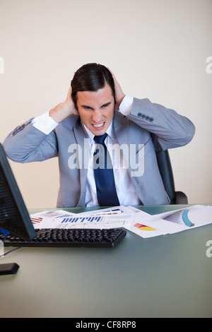 Businessman covering his ears - Stock Photo