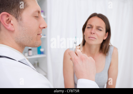 Doctor about to give an injection - Stock Photo