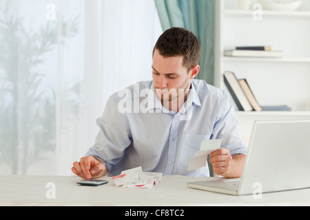 Businessman calculating - Stock Photo