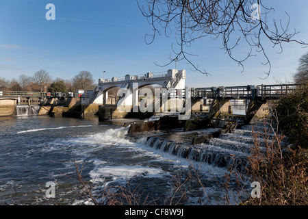 Teddington lock and weir on River Thames in early spring. - Stock Photo