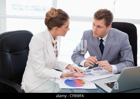 Business team talking about market research - Stock Photo