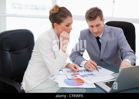 Business team analyzing market research - Stock Photo