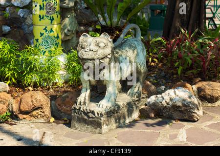 stone Statue in Wat Pho, Bangkok, Thailand - Stock Photo