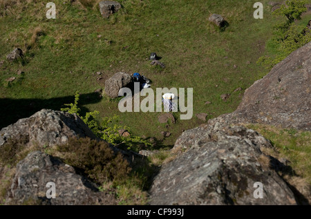 View showing the height perspective from the top of the climbing rock on the cliffs at Auchinstarry Quarry, Scotland. - Stock Photo