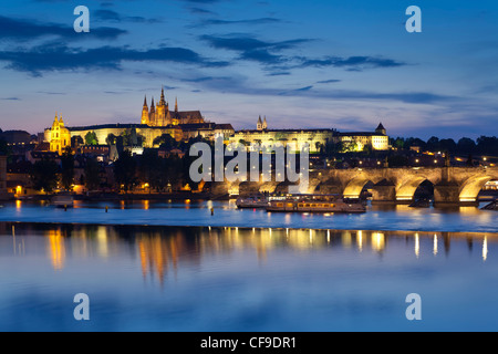 St. Vitus Cathedral, and the River Vltava at dusk, Prague, Czech Republic - Stock Photo