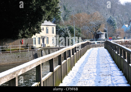 Lock keeper's house with snow covered footbridge over River Thames, at Marsh Lock, Henley-on-Thames, Berkshire, - Stock Photo