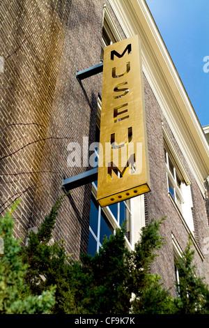 Old museum metal outdoor sign in Dordrecht - Stock Photo
