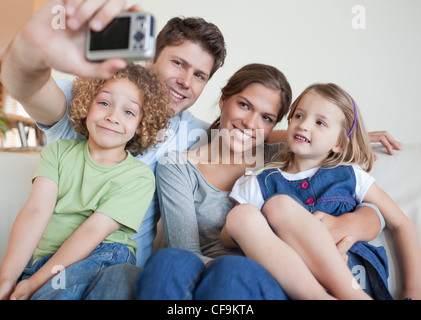 Family taking a photo of themselves - Stock Photo