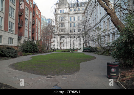 General view of Postman's Park, site of the Watts Memorial, is a quiet pot in the City of London, England. - Stock Photo