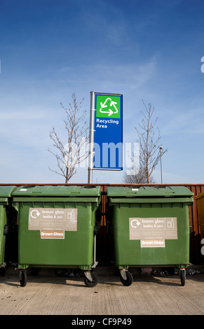 Two glass recycle bins in a recycling area, Cambridge UK - Stock Photo