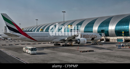 A B-777 300 at gate at Dubai airport - Stock Photo