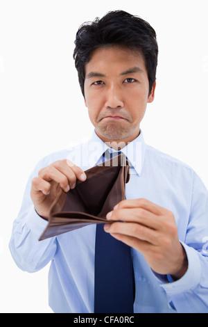 Portrait of a businessman showing his empty wallet - Stock Photo