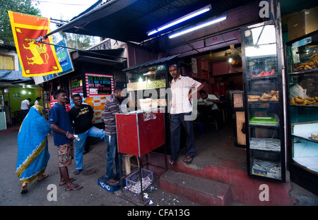 A small hole in the wall restaurant serving Appams and Kottu Roti in Kandy. - Stock Photo