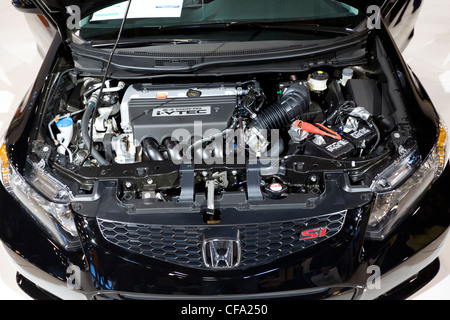 HOUSTON - JANUARY 2012: The Honda Civic Engine at the Houston International Auto Show on January 28, 2012 in Houston, - Stock Photo