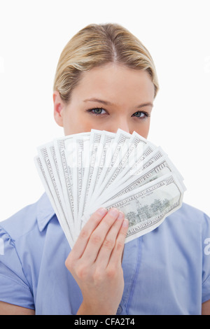 Woman hiding her face behind money - Stock Photo
