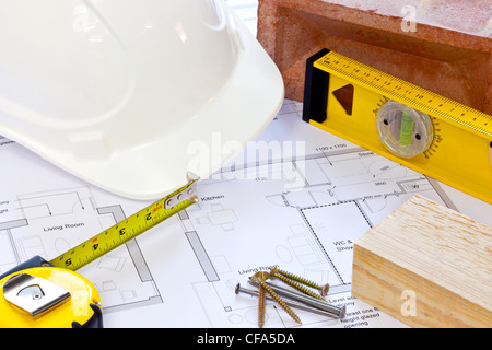 Still life photo of building plans and tools - Stock Photo