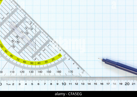 Still life photo of engineering graph paper with a fine 0.1mm pen with ruler and protractor - Stock Photo