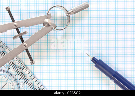 Still life photo of engineering graph paper with a fine 0.1mm pen, compass and ruler - Stock Photo