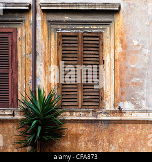 Shuttered window in stone wall - Stock Photo