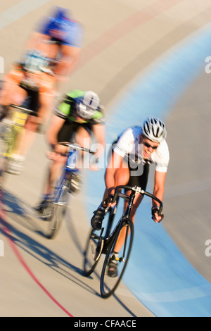 Cyclists on racing track. - Stock Photo