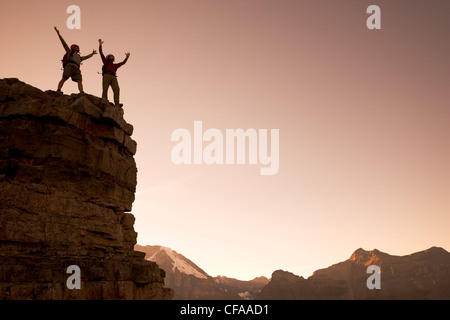 Two hikers climbing in Rocky Mountains, Canada. - Stock Photo