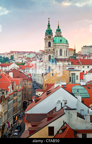 Church towers and rooftops of the Prague skyline in Prague, Czech Republic - Stock Photo