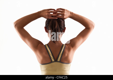 Woman fixing her hair - Stock Photo
