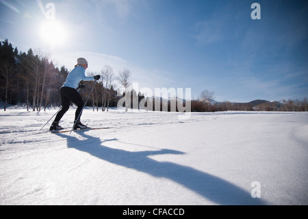 Cross country skier on snowy field - Stock Photo