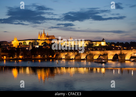 St. Vitus Cathedral, Charles Bridge and the Castle District illuminated at night, Prague, Czech Republic - Stock Photo