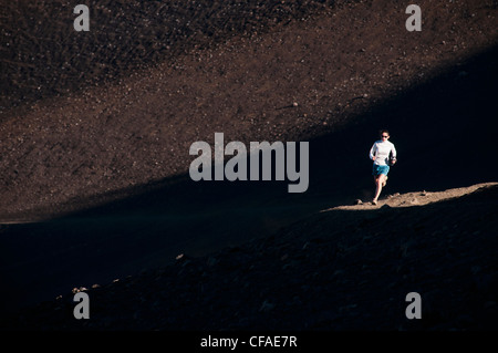 Woman running on dirt road - Stock Photo