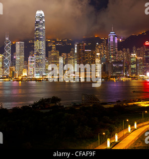 Elevated view across the busy Hong Kong harbour, Central district of Hong Kong Island and Victoria Peak, Hong Kong, - Stock Photo