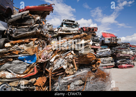 Stacked and Crushed Automobiles at a Scrap Metal Recycling Junkyard, Quebec, Canada - Stock Photo