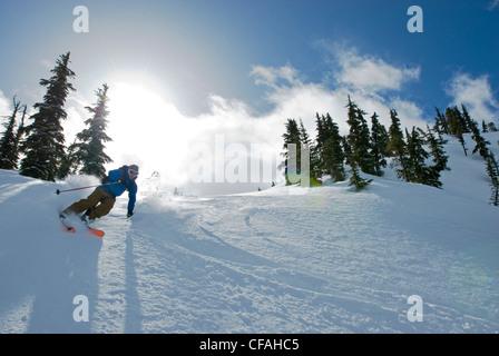 Skier heading down the north side of Iago Peak, Cascade Mountains near the Coquihalla summit, British Columbia, - Stock Photo