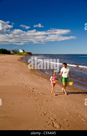 Young woman with daughter explore beach on Panmure Island, Points East Scenic Route, Prince Edward Island, Canada. - Stock Photo