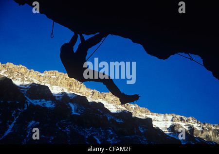 Rock climber hanging from cliff, Alberta, Canada. - Stock Photo