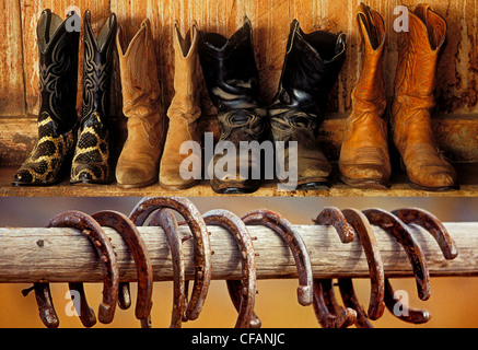 Western motif with cowboy boots and horseshoes on display, British Columbia, Canada - Stock Photo