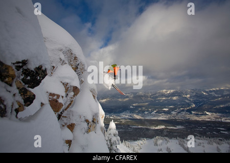 A skier catching big air in the backcountry of Kicking Horse, Golden, British Columbia, Canada - Stock Photo