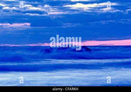 Waves breaking over rocks, Presqu'ille, Cape Breton Highlands National Park, Nova Scotia, Canada. - Stock Photo
