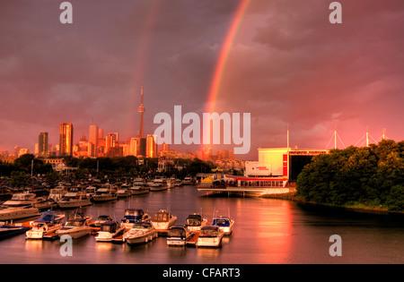 Boats in marina after storm with rainbow, Toronto, Ontario, Canada - Stock Photo