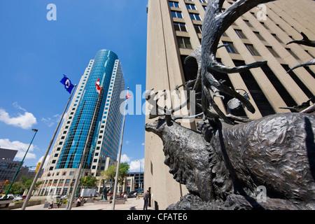 Bronze sculpture caribous crossing river titled