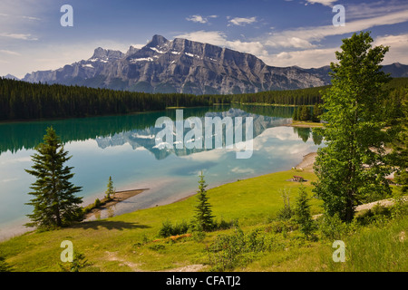 Two Jack Lake with mountain reflections along the Lake Minnewanka Loop Road in Banff National Park, Alberta, Canada - Stock Photo