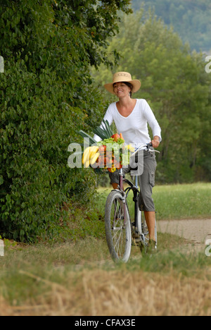 Summer, food, nutrition, land life, health, vegetables, fruits, purchase, vitamins, bicycle, bike, healthy, woman, - Stock Photo