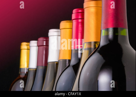Wine bottle necks with limited depth of field on black - Stock Photo