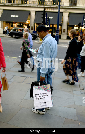 A man lost in Oxford street, London. - Stock Photo