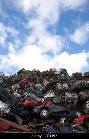 piles of crushed scrapped cars at metal recycling site Belfast Northern Ireland UK - Stock Photo