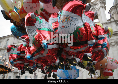Santa balloons for sale at an outdoor market in Rome Italy - Stock Photo
