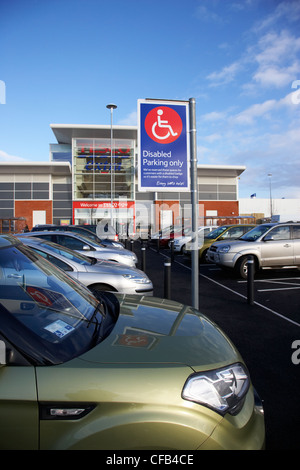 disabled car parking spaces outside tesco extra supermarket outside Belfast Northern Ireland UK - Stock Photo