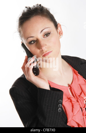 young woman talks on the telephone - Stock Photo
