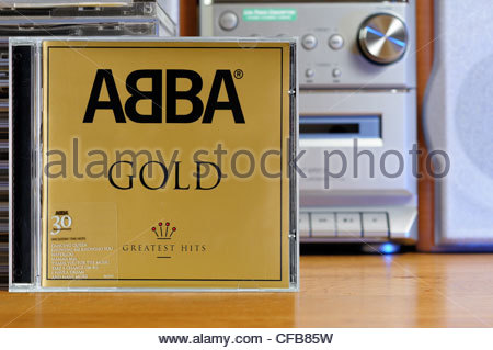 Abba Gold, Greatest Hits album on a stack of CD cases, England - Stock Photo
